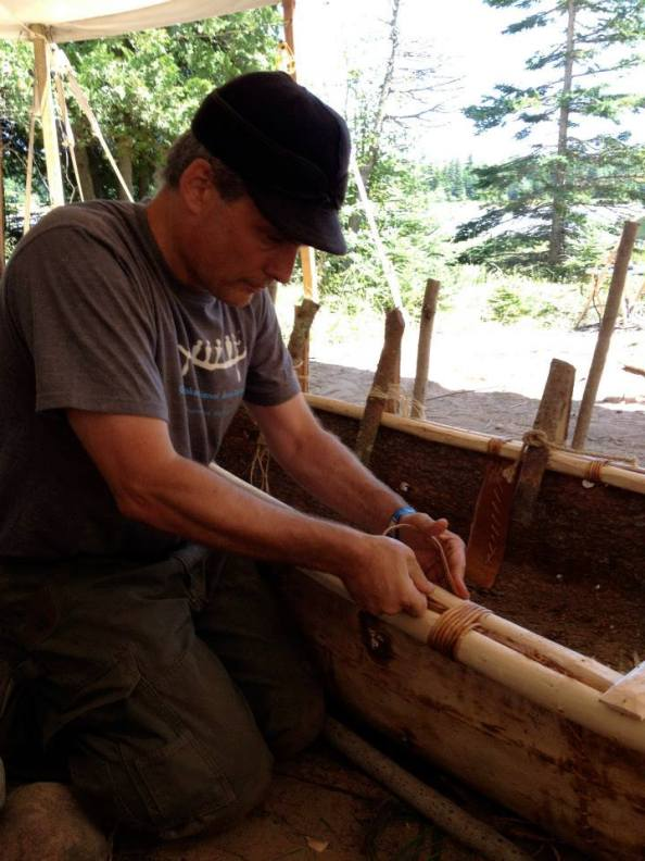 Lashing the gunwales tightly with split spruce root