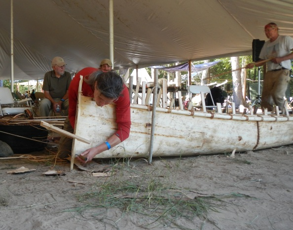 The ends of the canoe are sewn shut using spruce root lashed over a cedar batten strip.